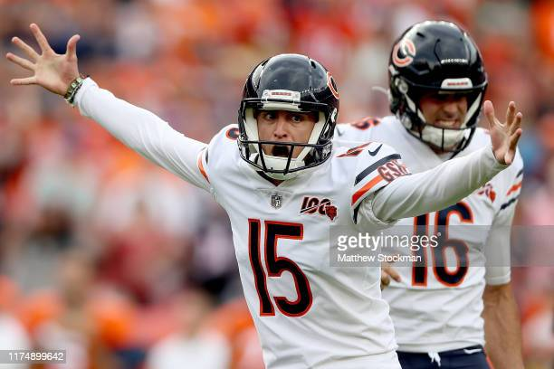 Pat O'Donnell holds as Eddy Pineiro of the Chicago Bears celebrate a 40 yard field goal in the second quarter against the Denver Broncos at Empower...