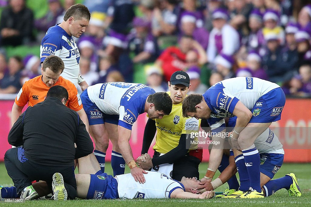Pat O'Hanlon of the Bulldiogs is consoled by teamates after an injury of the Bulldogs during the NRL 2nd Elimination Final match between the Melbourne Storm and the Canterbury Bankstown Bulldogs at AAMI Park on September 14, 2014 in Melbourne, Australia.