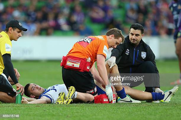 Pat O'Hanlon of the Bulldogs is attended to by trainers after injuring his leg during the NRL 2nd Elimination Final match between the Melbourne Storm...
