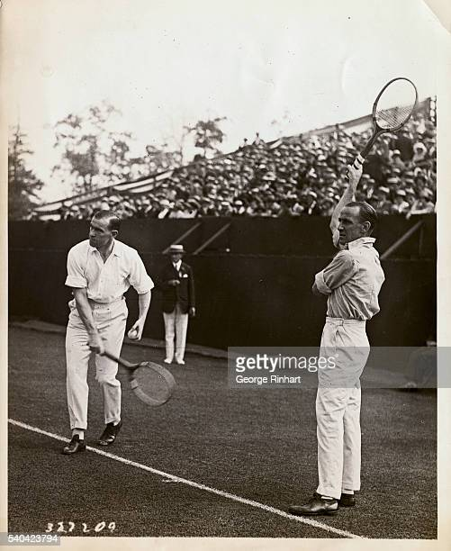 Pat O'Hara Wood and Gerald Patterson playing at West Side Tennis Club, Forest Hills, L.I., against the American team in Davis Cup doubled play.