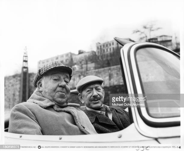 Pat O'Malley and Vaughn Taylor sitting in car in a scene from the film 'The Gumball Rally', 1976.