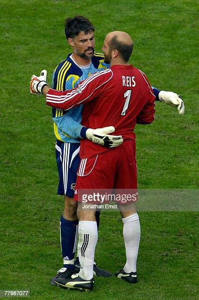 Pat Onstad of the Houston Dynamo is greeted by Matt Reis of the New England Revolution after the 2007 Major League Soccer Cup at RFK Stadium on...