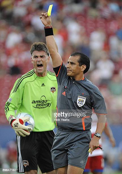 Pat Onstad of the Houston Dynamo reacts to receiving a yellow card from referee Baldomero Toledo at Pizza Hut Park August 6, 2009 in Frisco, Texas.