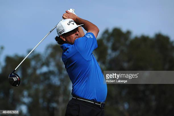 Pat Perez hits a tee shot on the 9th hole during the first round of the Farmers Insurance Open on Torrey Pines South on January 23 2014 in La Jolla...