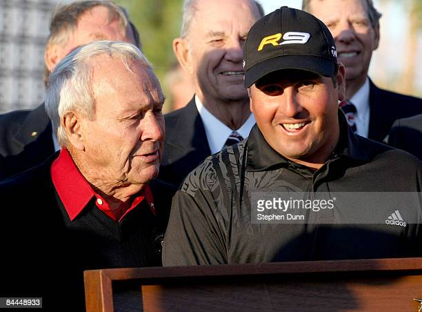 Pat Perez is congratulated by tournament host Arnold Palmer after Perez' three stroke victory on the Palmer Private course at PGA West during the...
