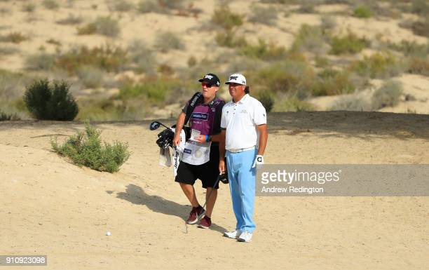 Pat Perez of the United States and his caddie look on from the 8th hole during day three of Omega Dubai Desert Classic at Emirates Golf Club on...