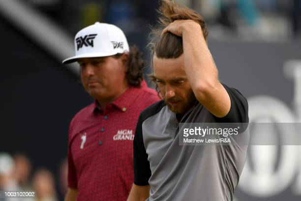 Pat Perez of the United States and Tommy Fleetwood of England react on the 18th hole green during round three of the Open Championship at Carnoustie...