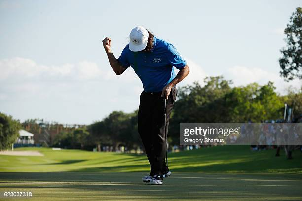 Pat Perez of the United States celebrates after making a par on the 18th green to win the OHL Classic at Mayakoba on November 13 2016 in Playa del...