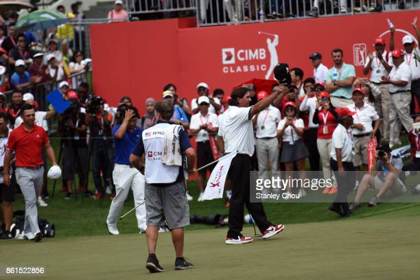 Pat Perez of the United States celebrates on the 18th hole after the final round of the 2017 CIMB Classic at TPC Kuala Lumpur on October 15 2017 in...