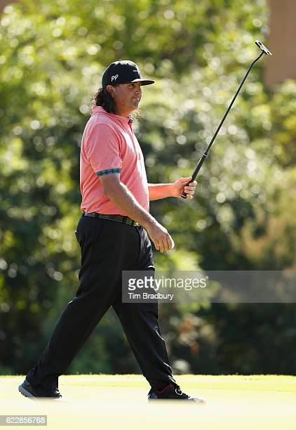 Pat Perez of the United States gestures to the crowd after making a birdie putt on the 17th green during the third round of the OHL Classic at...