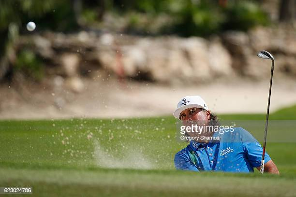 Pat Perez of the United States hits to the sixth green from a greenside bunker during the final round of the OHL Classic at Mayakoba on November 13...