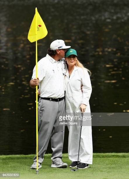 Pat Perez of the United States kisses his wife Ashley during the Par 3 Contest prior to the start of the 2018 Masters Tournament at Augusta National...