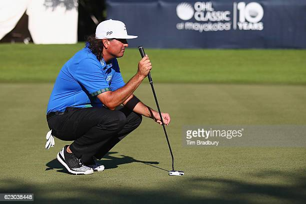 Pat Perez of the United States lines up a putt on the 18th green prior to winning the OHL Classic at Mayakoba on November 13 2016 in Playa del Carmen...