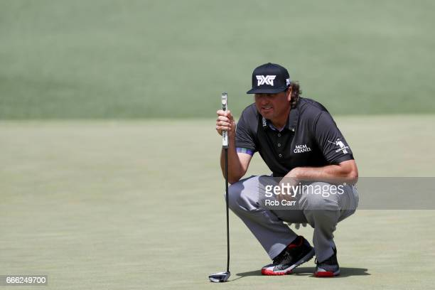 Pat Perez of the United States lines up a putt on the second green during the third round of the 2017 Masters Tournament at Augusta National Golf...