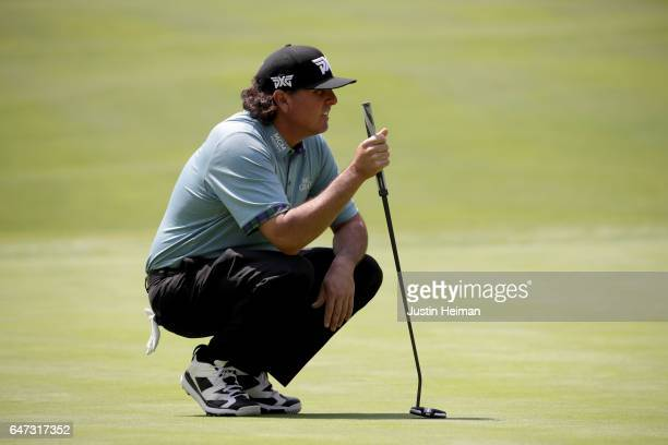 Pat Perez of the United States lines up his putt on the fifth hole green during the first round of the World Golf Championships Mexico Championship...