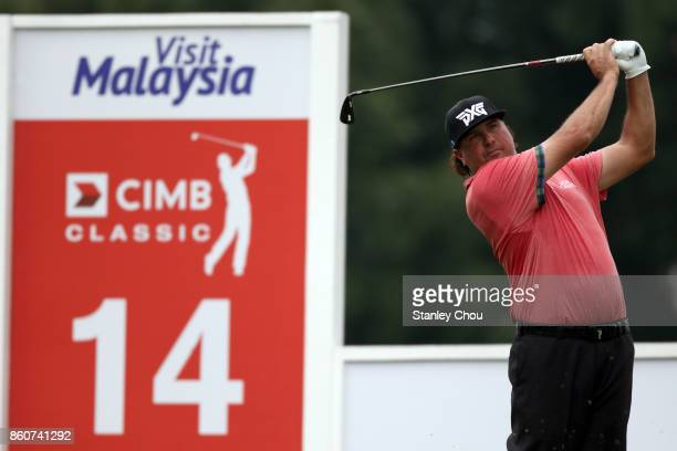 Pat Perez of the United States plays a shot on the 14th hole during round two of the 2017 CIMB Classic at TPC Kuala Lumpur on October 13 2017 in...