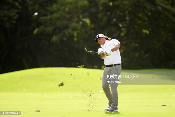 Pat Perez of the United States plays his second shot on the tenth hole during the first round of the Sony Open in Hawaii at the Waialae Country Club...
