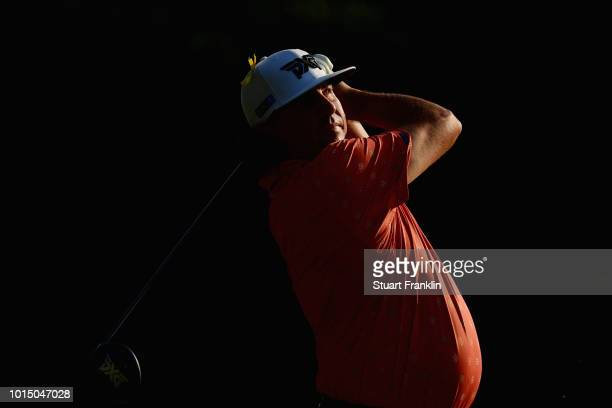 Pat Perez of the United States plays his shot from the 15th tee during the continuation of the weather delayed second round of the 2018 PGA...