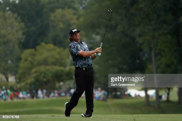 Pat Perez of the United States plays his shot on the 11th hole during the first round of the 2017 PGA Championship at Quail Hollow Club on August 10...