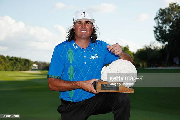 Pat Perez of the United States poses with the 2016 Champion's Trophy after winning the OHL Classic at Mayakoba on November 13 2016 in Playa del...