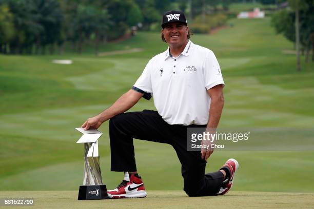 Pat Perez of the United States poses with the CIMB Classic trophy after the final round of the 2017 CIMB Classic at TPC Kuala Lumpur on October 15...
