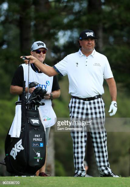 Pat Perez of the United States pulls a club from his bag as he prepares to play a shot from the second tee during the final round of the Sentry...