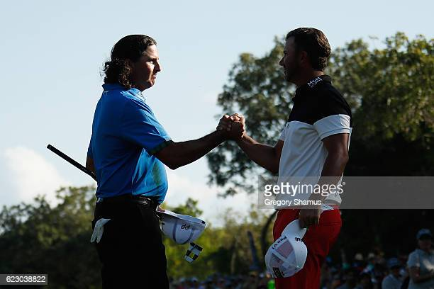 Pat Perez of the United States shakes hands with Scott Piercy of the United States after winning the OHL Classic at Mayakoba on November 13 2016 in...