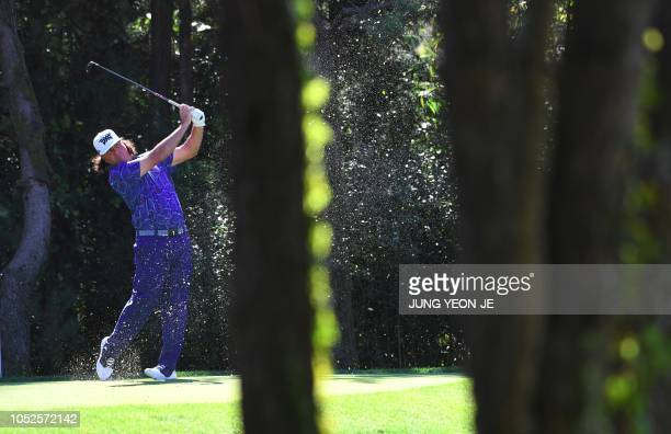 TOPSHOT Pat Perez of the US tees off on the seventh hole during the third round of the CJ Cup golf tournament at Nine Bridges golf club in Jeju...