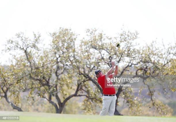 Pat Perez take his second shot on the 18th during Round Two of the Valero Texas Open at TPC San Antonio ATT Oaks Courseon March 28 2014 in San...