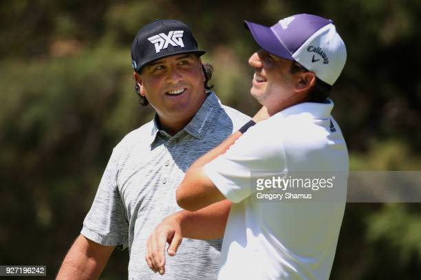 Pat Perez talk to Sergio Garcia of Spain on the second green during the final round of World Golf ChampionshipsMexico Championship at Club De Golf...