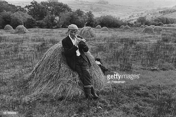 Pat Phildy plays his penny whistle in a field in Tawnylea County Leitrim Ireland circa 1974