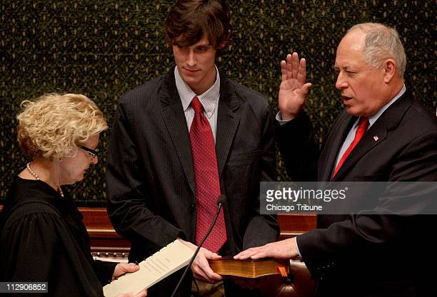 Pat Quinn is sworn in as Illinois governor by Illinois Justice Anne Burke as his son Patrick Quinn holds the bible on Thursday January 29 in...