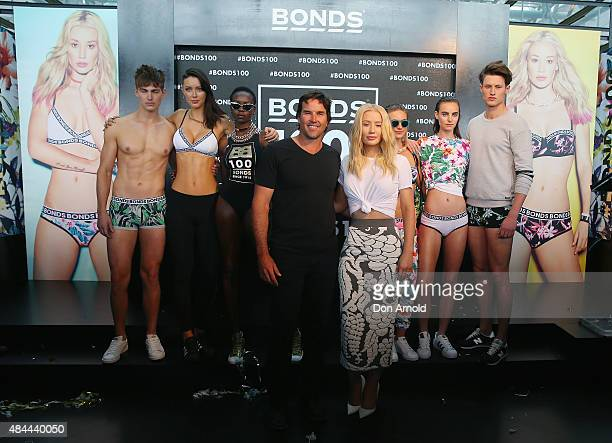 Pat Rafter and Iggy Azalea pose during Bonds 100th birthday celebration event at Cafe Sydney on August 19, 2015 in Sydney, Australia.