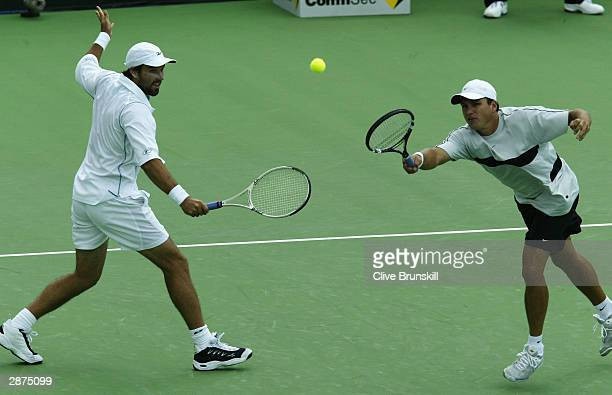 Pat Rafter and Josh Eagle of Australia compete for the ball during their doubles match at the Commonwealth Bank International at Kooyong Lawn Tennis...