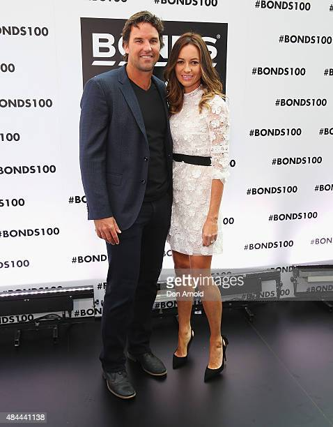 Pat Rafter and Lara Feltham pose during Bonds 100th birthday celebration event at Cafe Sydney on August 19 2015 in Sydney Australia