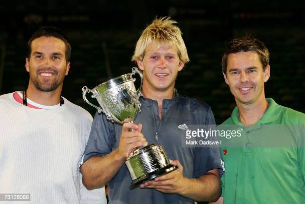 Pat Rafter and Todd Woodbridge pose with Brydan Klein of Australia after winning his junior final match against Jonathan Eysseric of France on day...