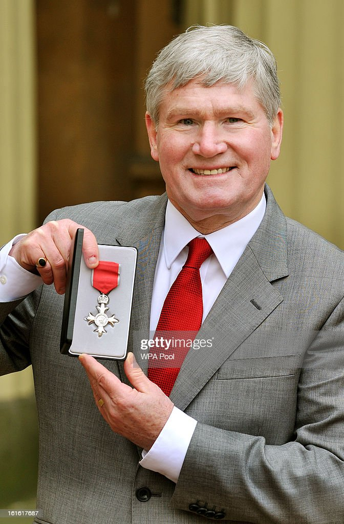 Pat Rice holds his Member of the British Empire (MBE) medal after it was presented to him by Queen Elizabeth II at the Investiture Ceremony at Buckingham Palace on February 13, 2012 in London, England.