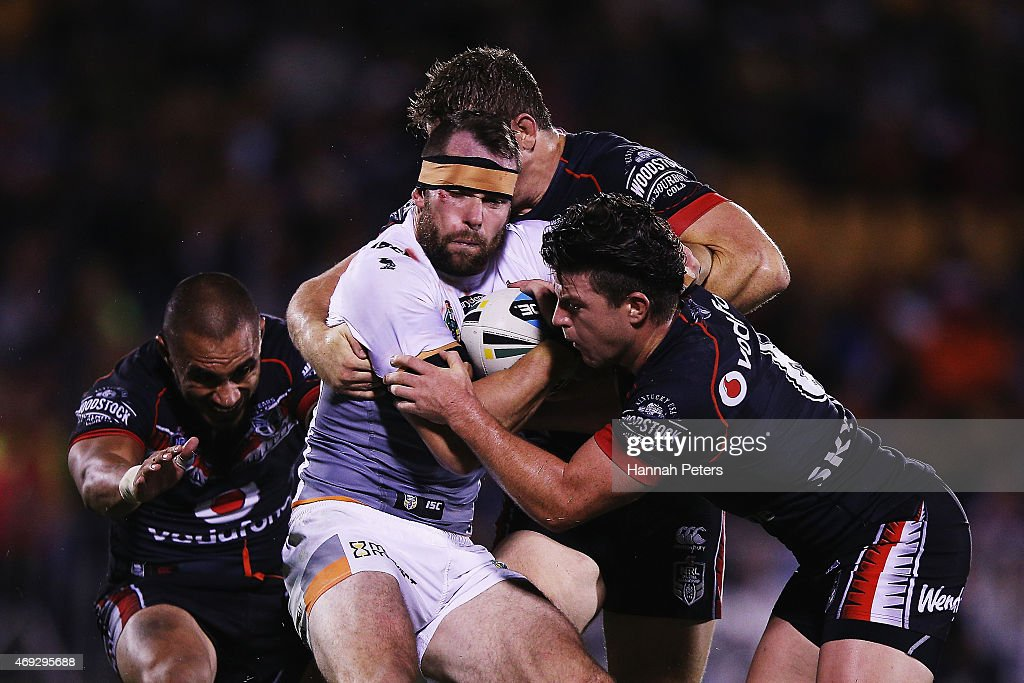 Pat Richards of the Tigers charges forward during the round six NRL match between the New Zealand Warriors and the Wests Tigers at Mt Smart Stadium on April 11, 2015 in Auckland, New Zealand.