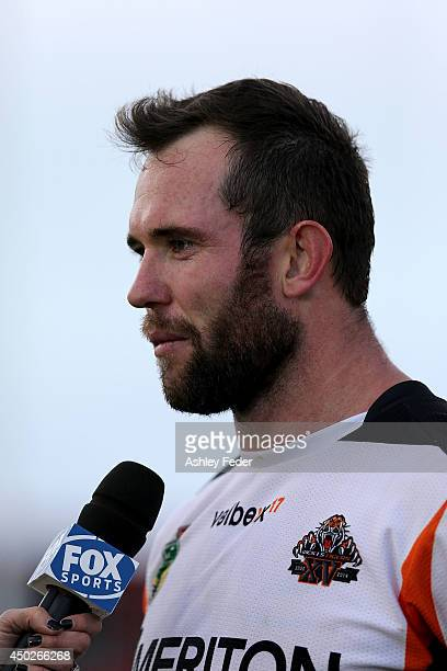 Pat Richards of the Tigers is interviewed after the round 13 NRL match between the Newcastle Knights and the Wests Tigers at Hunter Stadium on June 8...