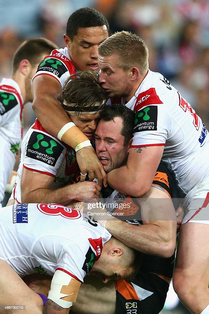 Pat Richards of the Tigers is tackled during the round 26 NRL match between the St George Illawarra Dragons and the Wests Tigers at ANZ Stadium on September 5, 2015 in Sydney, Australia.