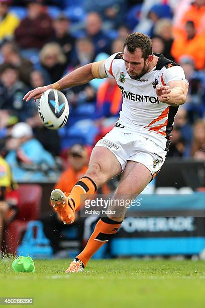Pat Richards of the Tigers kicks a goal during the round 13 NRL match between the Newcastle Knights and the Wests Tigers at Hunter Stadium on June 8...