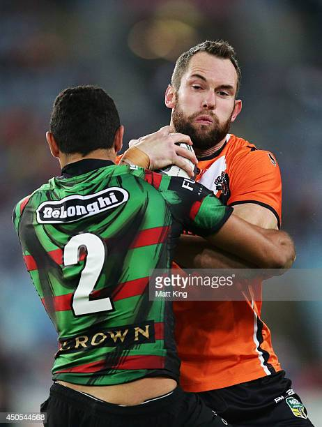 Pat Richards of the Tigers takes on the defence during the round 14 NRL match between the South Sydney Rabbitohs and the Wests Tigers at ANZ Stadium...