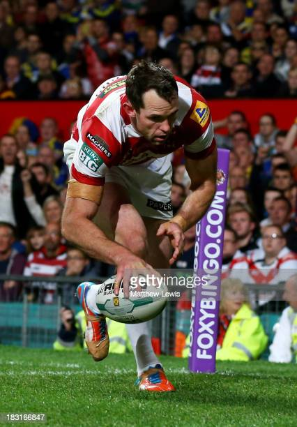 Pat Richards of Wigan touches down to score his team's fifth try during the Super League Grand Final between Warrington Wolves and Wigan Warriors at...