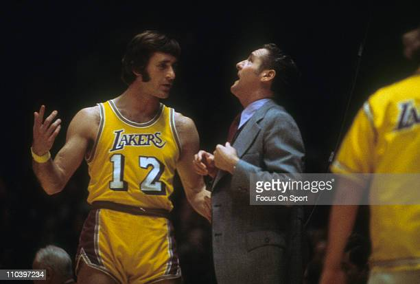 Pat Riley of the Los Angeles Lakers talks to Head coach Bill Sharman during an NBA basketball game circa 1973 at the Forum in Inglewood California...