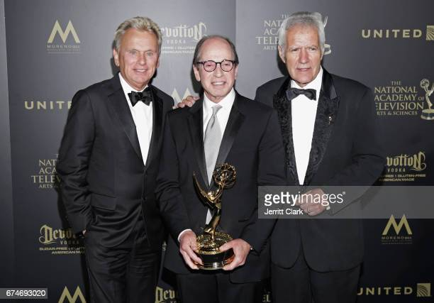 Pat Sajak, Harry Friedman and Alex Trebek attend the 44th Annual Daytime Creative Arts Emmy Awards - Press Room at Pasadena Civic Auditorium on April...