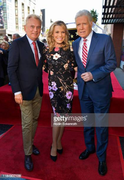Pat Sajak, Vanna White, Alex Trebek pose for portrait at Harry Friedman Honored With A Star On The Hollywood Walk Of Fame on November 01, 2019 in...