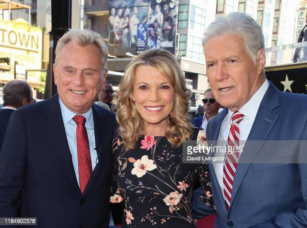 Pat Sajak, Vanna White and Alex Trebek attend Harry Friedman being honored with a Star on the Hollywood Walk of Fame on November 01, 2019 in...