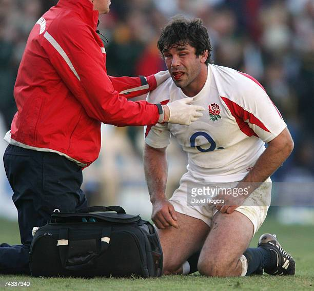 Pat Sanderson of England receives attention during the rugby union international match between South Africa and England at Vodacom Park on May 26...