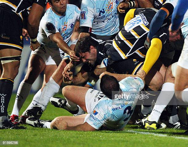 Pat Sanderson of Worcester dives over to score the first try during the Amlin Challenge Cup match between Worcester Warriors and Montpellier at...