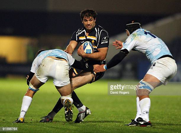 Pat Sanderson of Worcester is tackled during the Amlin Challenge Cup match between Worcester Warriors and Montpellier at Sixways on October 8, 2009...